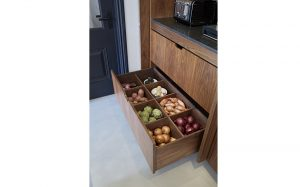 Open kitchen drawer with vegetable storage