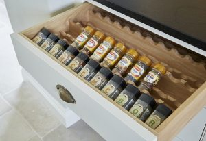 A spice rack built in to a kitchen drawer