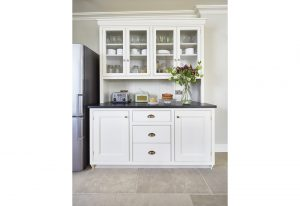 A handsome kitchen pantry in white