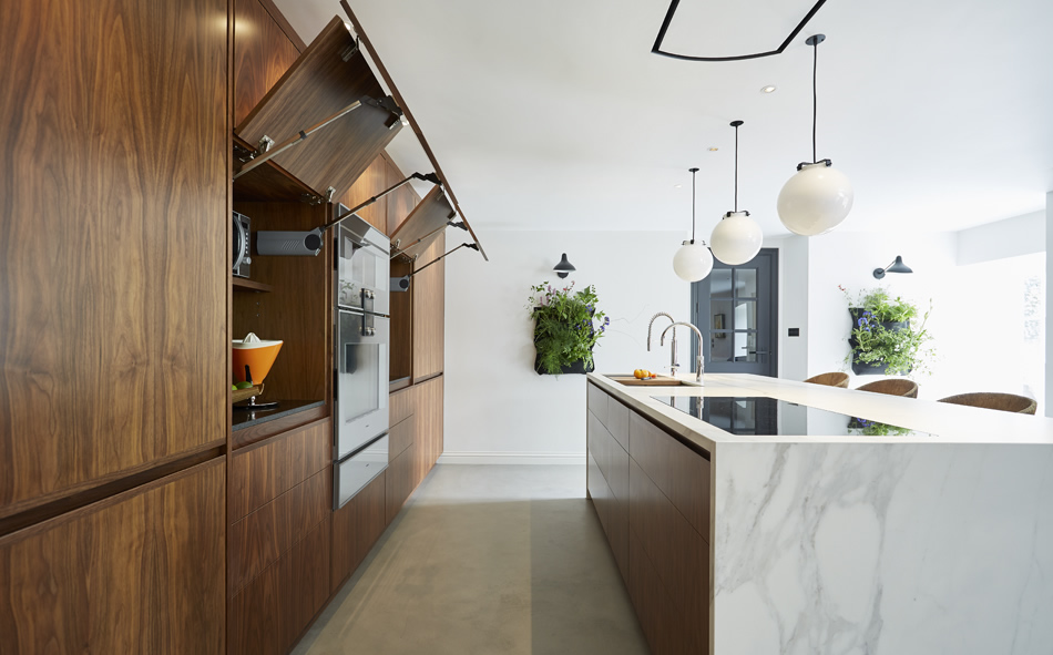 Clever cantilevered kitchen cupboards keep clean lines