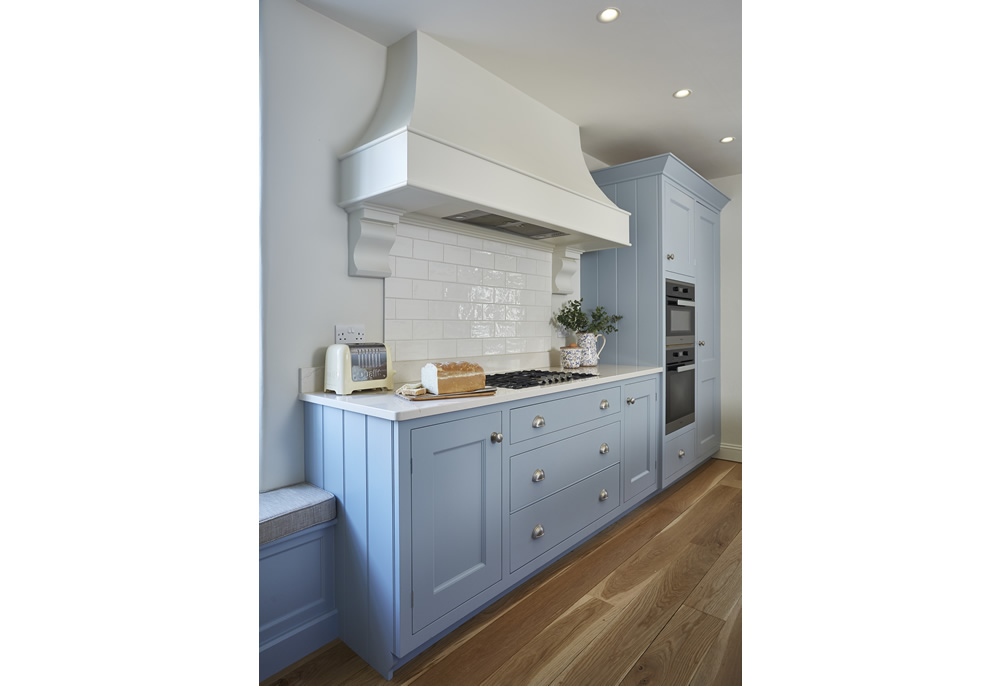 Handmade wooden cabinetry painted in duckegg blue