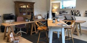 Handmade wooden tables in the all new Barnes office here in Devon