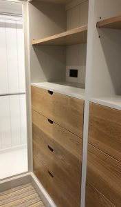 Handmade wooden drawers offer useful storage in this Barnes bedroom design