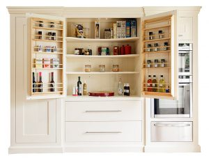 A handmade wooden kitchen pantry with internal lighting