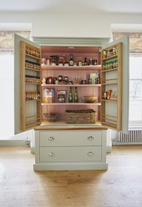 A handmade kitcehn pantry from barnes shown crammed with preserved food in containers
