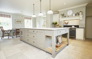 Light coloured stone tiles in an airy modern kitchen