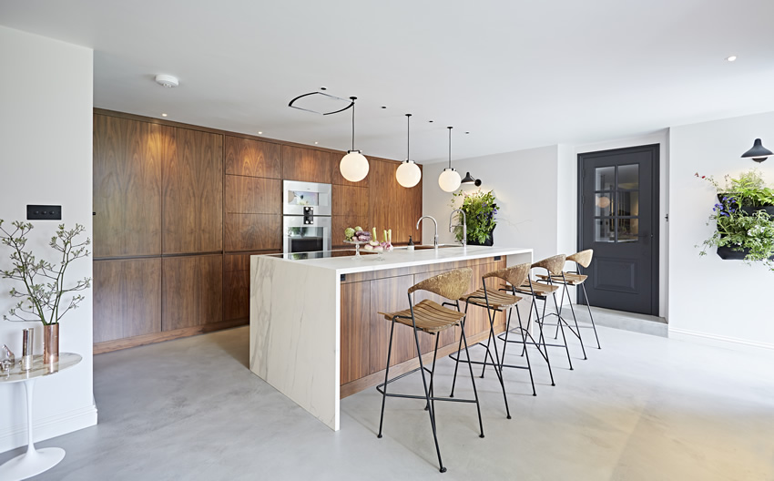 A contemporary kitchen stone floor